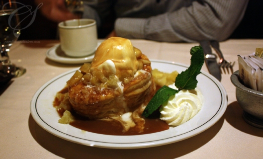 Hot apple croûte - a puff pastry topped with bits of apple, vanilla ice cream and rich, hot caramel. 2 forks please!