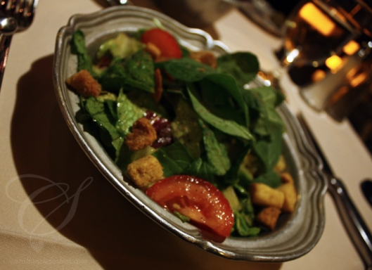 The Gibby's salad: mixed greens with tomatoes, croutons and a light garlic dressing.