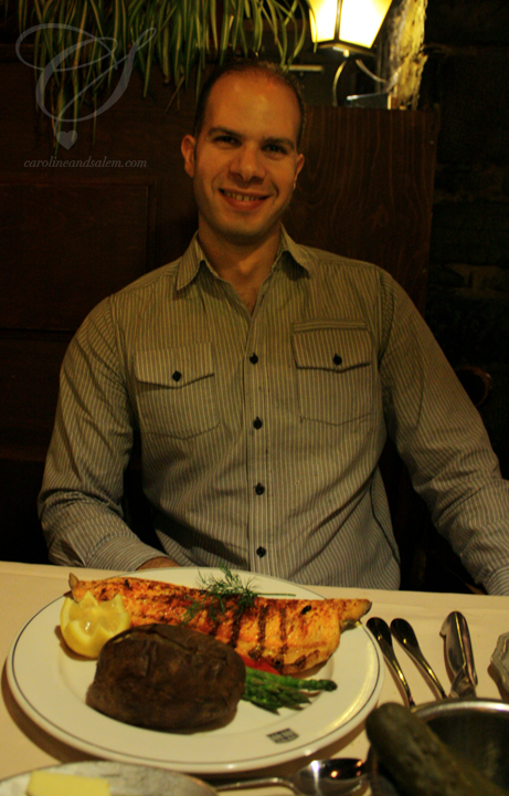 Salem telling me to take the picture quickly. On his plate: the grilled arctic char, baked potato and asparagus.