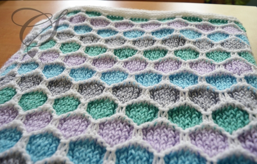 One closeup of the blanket and the honeycomb pattern.